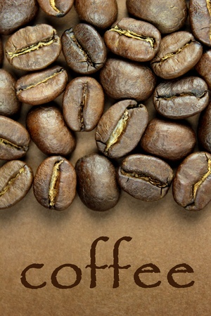 Coffee beans and ' coffee ' text on brown background photo