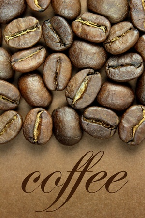 Coffee beans and   coffee   text on brown background Stock Photo
