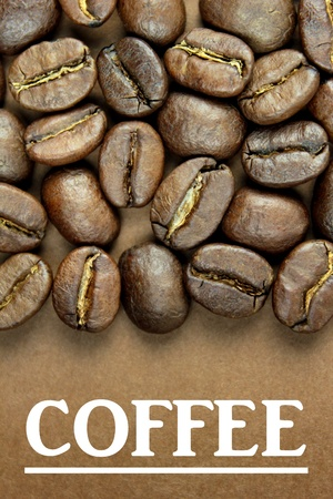 Coffee beans and white ' COFFEE ' text on brown background photo