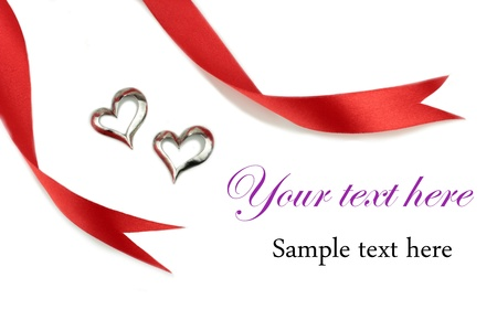 Red ribbon and silver hearts shape photo