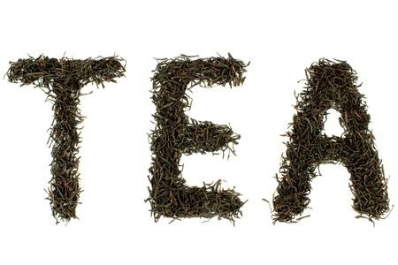 tea crop:  TEA  text , with dry black tea leaves
