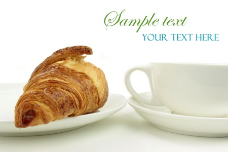 traditionally french: Croissant and coffee cup on white background