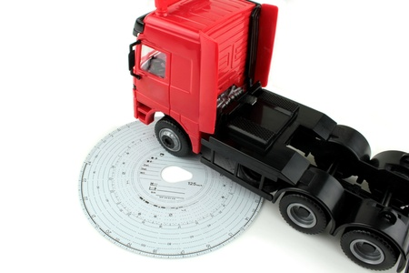Analogue Tachograph card and truck photo