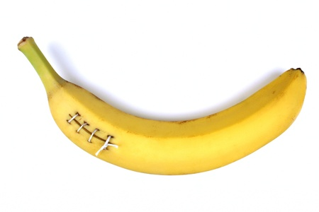 wound care: Injured banana stitched up Stock Photo