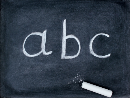abc letters and chalk on blackboard Stock Photo