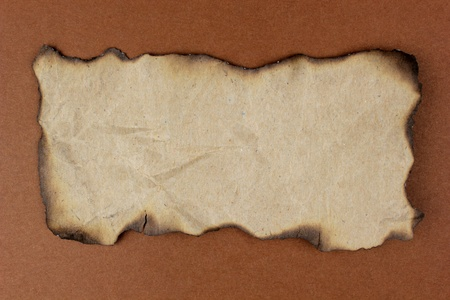 burned paper: Burnt natural paper for background and your message