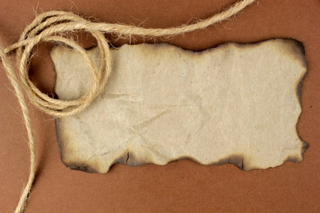 Burnt paper and flax string for background photo