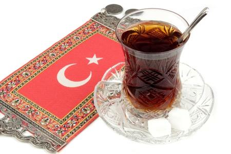 turkish: Turkish tea with traditional crystal tea glass and turkish flag Stock Photo