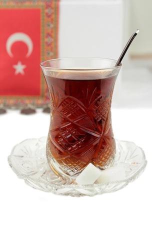 the turkish flag: Turkish tea with traditional crystal tea glass and turkish flag Stock Photo