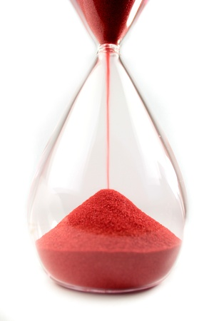 Hourglass with red sand Stock Photo