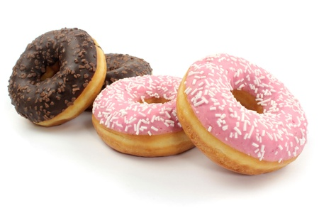 Sweet donuts on white background  photo