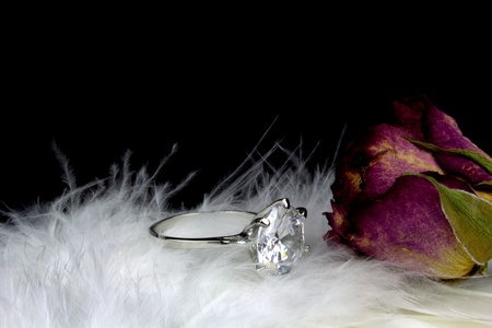 Diamond solitaire ring, rose on white feather