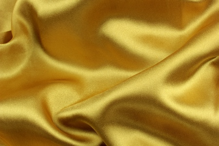 Golden wavy silk fabric photo