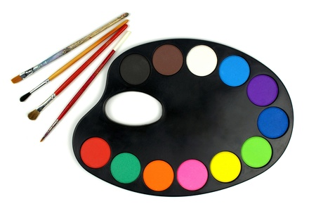 Water colors on black palette and paintbrushes  photo