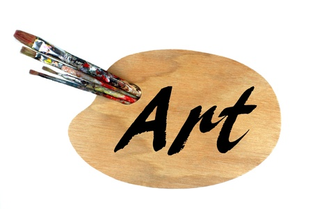 Paintbrushes and palette on white background  photo