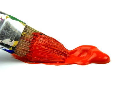 Paintbrush and red oil color photo