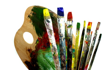color color palette: Paintbrushes and palette on white background