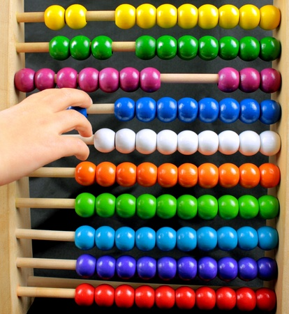 addition: Colorful abacus and child hand