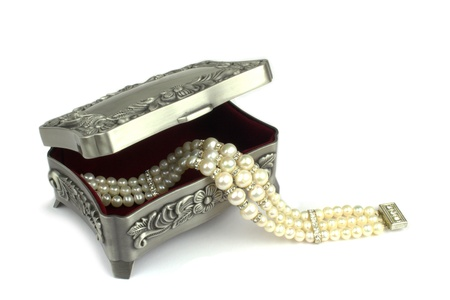jewelry boxes and pearl bracelet photo