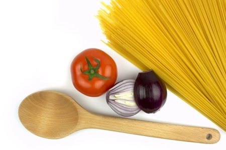 Pasta, tomato, red onion and wooden spoon Stock Photo - 13270414