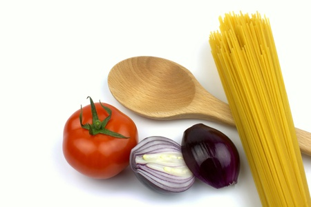 Pasta, tomato, red onion and wooden spoon  photo