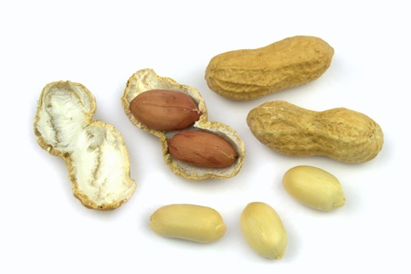 Peanuts and opened shell on a white background photo