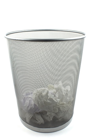 Metal trash bin on white background photo