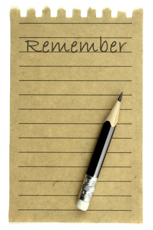 Handwriting   Remember   on a natural note paper and pencil photo