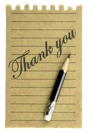 Handwriting   Thank you   on a natural note paper and pencil photo