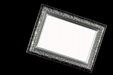 Antique silver and patterned picture frame black and white background photo