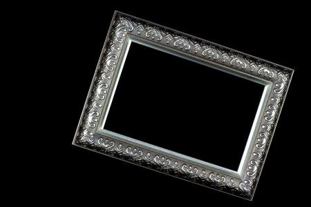 Antique silver and patterned picture frame black background Stock Photo - 13638340