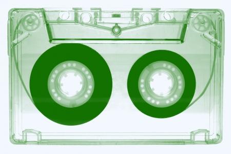 audio cassette: Green audio cassette isolated on white background Stock Photo