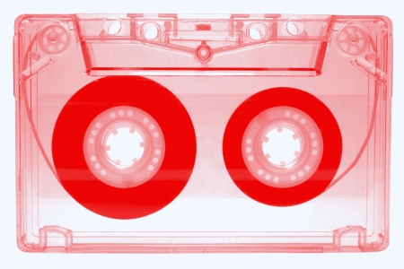 audio cassette: Red audio cassette isolated on white background