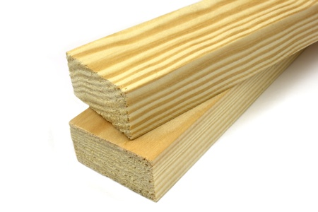 carpenter's sawdust: Wood planks on a white background Stock Photo