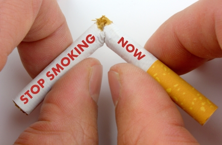 patience:   Stop smoking now   text on a broken cigarette  Stock Photo