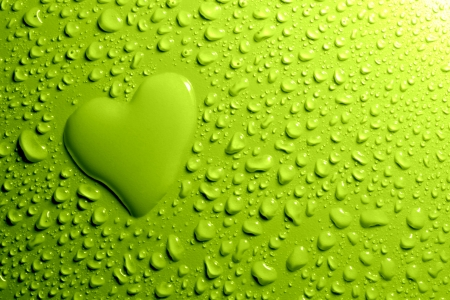 Water drops and heart shape on green background photo