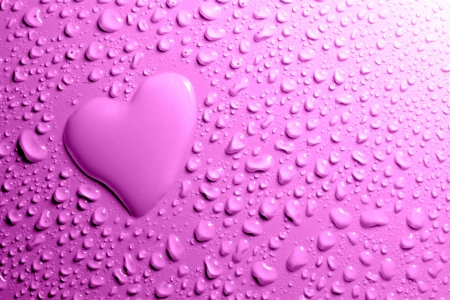 Water drops and heart shape on purple background photo
