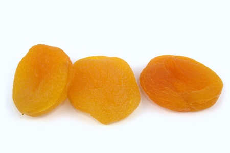 apricot kernel: Sun dried apricots on white background  Stock Photo
