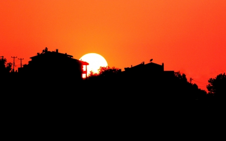 sunup: Sunset with town silhouette. Stock Photo