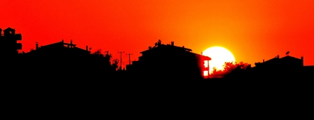 sunup: sunset with town silhouette  Stock Photo