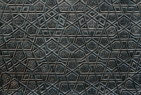 Detail from one of the bronze doors of the 395 year old Blue Mosque in Istanbul, Turkey