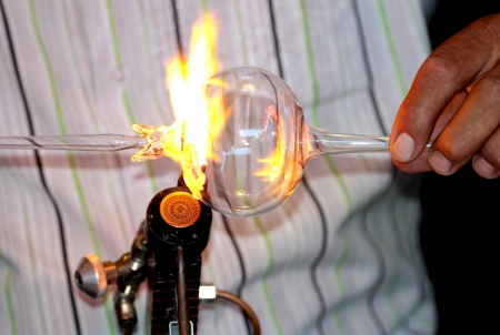making a fire: Glass blowing Stock Photo