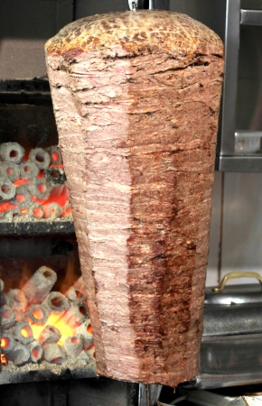 Turkish doner kebab with real coal fire. Stock Photo
