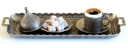 Turkish coffee and turkish delight with old traditional embossed  metal cup and tray photo
