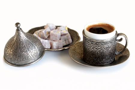 Turkish coffee and turkish delight with old traditional embossed  metal cup photo