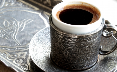 Turkish coffee with  old traditional embossed  metal cup and tray photo