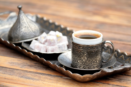 Turkish coffee and turkish delight with  old traditional embossed  metal cup and tray
