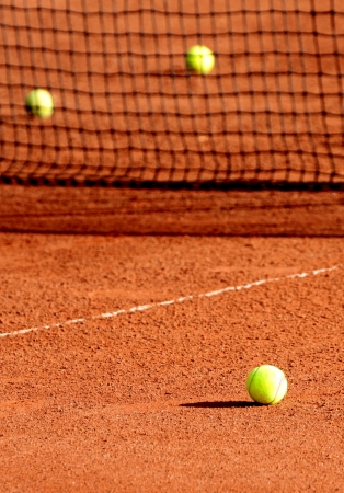 red clay: Tennis balls on a tennis clay court