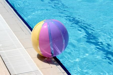 swimmingpool: Beachball and swimmingpool. Stock Photo