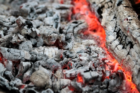 elemental: warm glowing embers with gray ash and coals